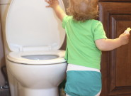 Baby-lifting-a-toilet-lid-000067847133_Large